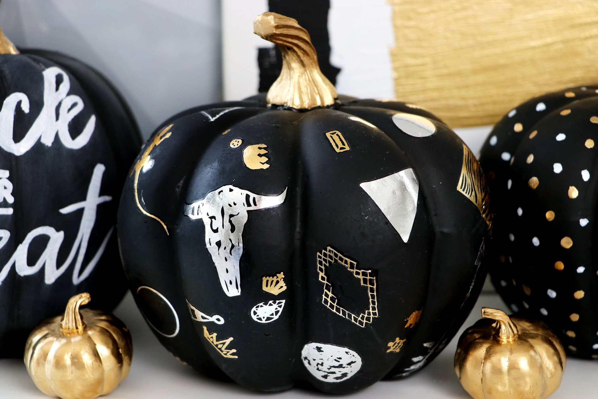 And then I think this one is my favorite. To get these detailed metallic  images onto the pumpkin, all you have to do is use temporary tattoos!