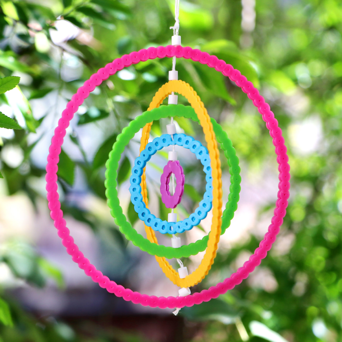 20 Ways To Spiff Up Your Backyard For Spring: DIY Perler Bead Rainbow Wind Spinners
