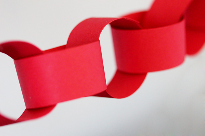 i also made a red paper chain out of cardstock to give the whole thing another pop of color this is super easy just cut up cardstock to pieces